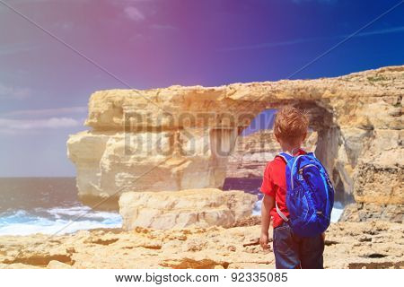little tourist looking at Azure Window on Gozo island