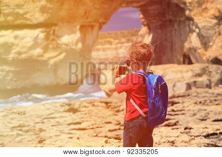 little boy making photo of Azure Window on Gozo island