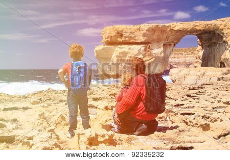 father and kids looking at Azure Window on Gozo island