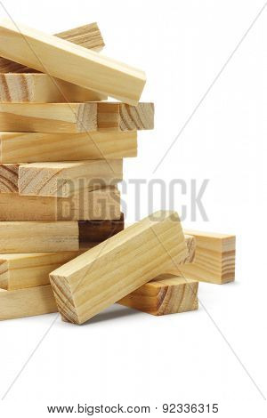 Stack of Wooden Building Blocks on White Background