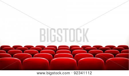 Rows of red cinema or theater seats in front of white blank screen with sample text space.