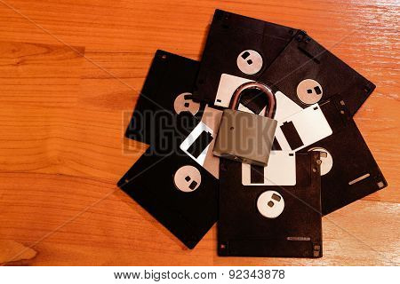 Closed Padlock And Floppy Discs