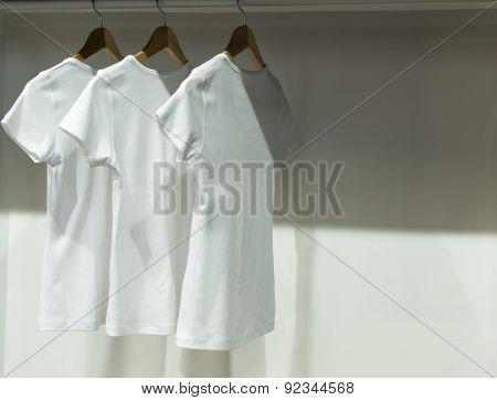 Three White T-shirts In Wardrobe