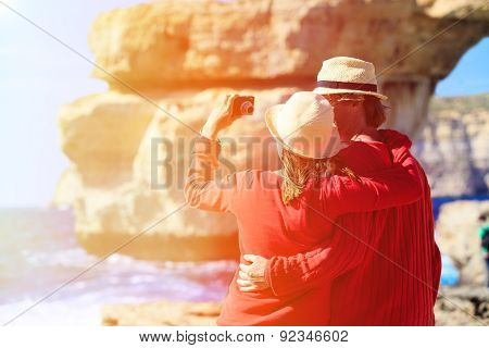 Tourist couple making selfie photo on Azure Window in Gozo island