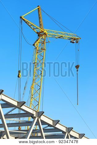 Hoisting Crane Against The Blue Sky