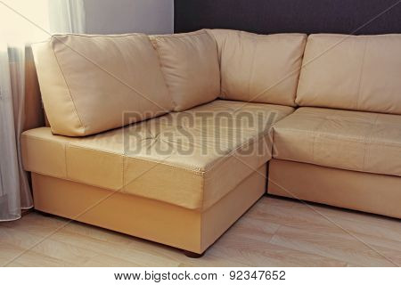 Modern Beige Corner Leather Sofa In Livingroom.