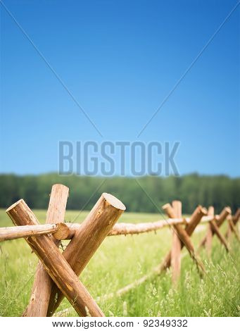 Wooden Fence In Field Encloses Farmer Economy