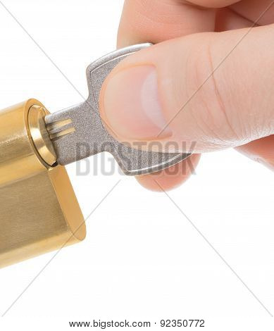 Hand Inserting Keys In Lock On A White Background