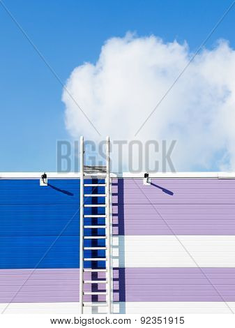 Cloud In Blue Sky And Ladder On A Wall