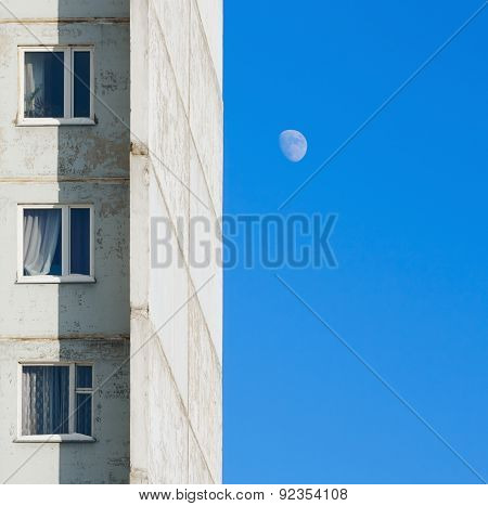 Fragment Apartment House Against The Blue Sky With The Moon