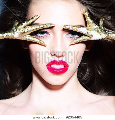 Young Undressed Woman With Gold Chicken Feet