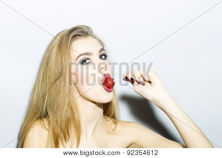 Impassioned Blonde Young Woman Portrait With Sugar Candy