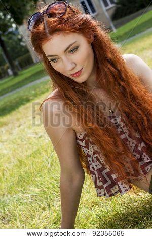 Happy Woman Lying On Grassy Ground
