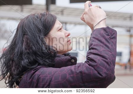 Photographer woman is holding camera taking photographs