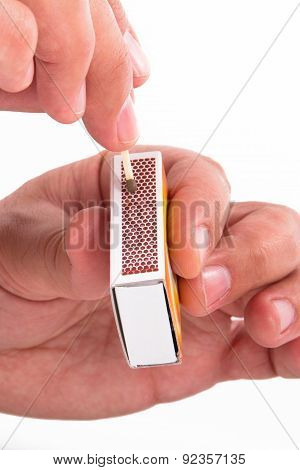 Hand And Matchbox