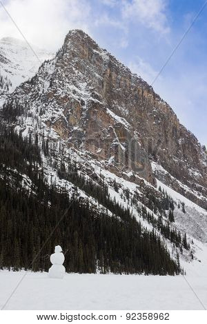 Snowman On Lake Louise In Front Of A Mountain