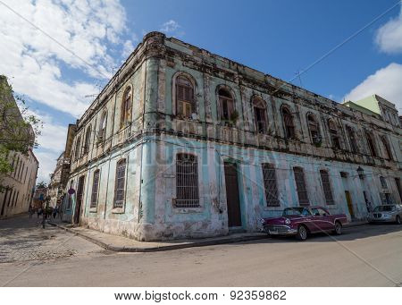 Old And Colorful Building In Havana With Pink Car In Front