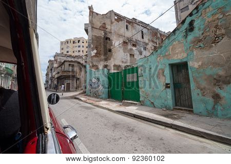 Looking Out Of A Car At A Green Wall Of A Ruin In Havana
