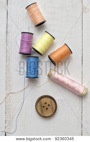 Bobbins With Thread On The Table