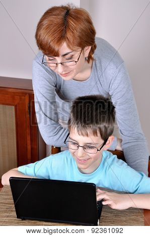 Woman and young boy with laptop