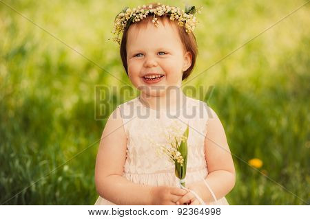 beautiful girl with a bouquet of lilies of the valley