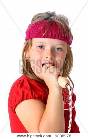 Small girl singing a song pretending her jump rope to be a microphone isolated on white