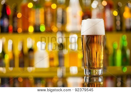 Jug of beer placed on bar counter with free space for text