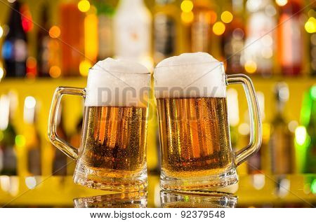 Jugs of beer placed on bar counter