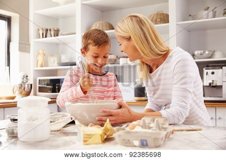 Mother and son baking together at home