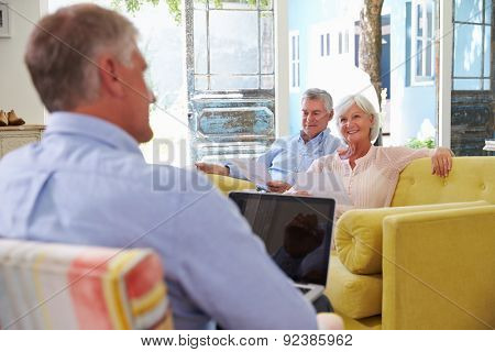 Senior Couple At Home Meeting With Financial Advisor