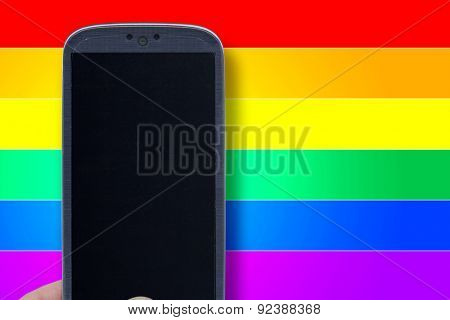 Blue smartphone and LGBT background. Idea for Valentines Day messages, LGBT love, lovers, love apps, Internet, blogs and others.