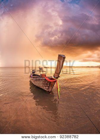 Long tailed boat Ruea Hang Yao in Phuket Thailand at sunset