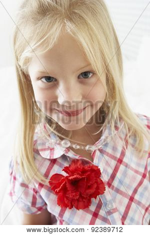 Young Girl Dressing Up In Bedroom