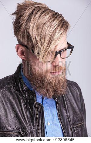 Portrait of a young hipster man looking down.