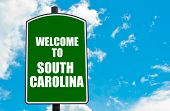 stock photo of south-pole  - Green road sign with greeting message Welcome to SOUTH CAROLINA isolated over clear blue sky background with available copy space - JPG