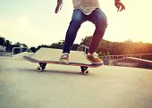 picture of skateboard  - closeup of skateboarder legs skateboarding at skatepark - JPG