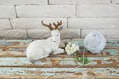 picture of deer family  - statuette with deer on old wood background - JPG