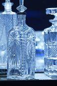 pic of liquor bottle  - Empty crystal bottles for liquor in blue tone. Vertical ** Note: Shallow depth of field - JPG