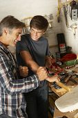 pic of workbench  - Father Teaching Son To Use Workbench In Garage - JPG