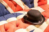 pic of bowler hat  - Union Jack Flag style modern cushioned sofa with black felt bowler hat - JPG