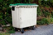 image of waste disposal  - Waste container with green lid on the street - JPG
