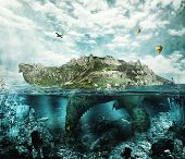 stock photo of turtle shell  - Huge turtle in ocean overgrown forests and mountains to the village and the castle in the shell floats like an island - JPG