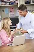 stock photo of lunch  - Couple Having Working Lunch In Home Office Together - JPG
