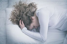 picture of suffering  - Woman suffering for depression lying in bed - JPG