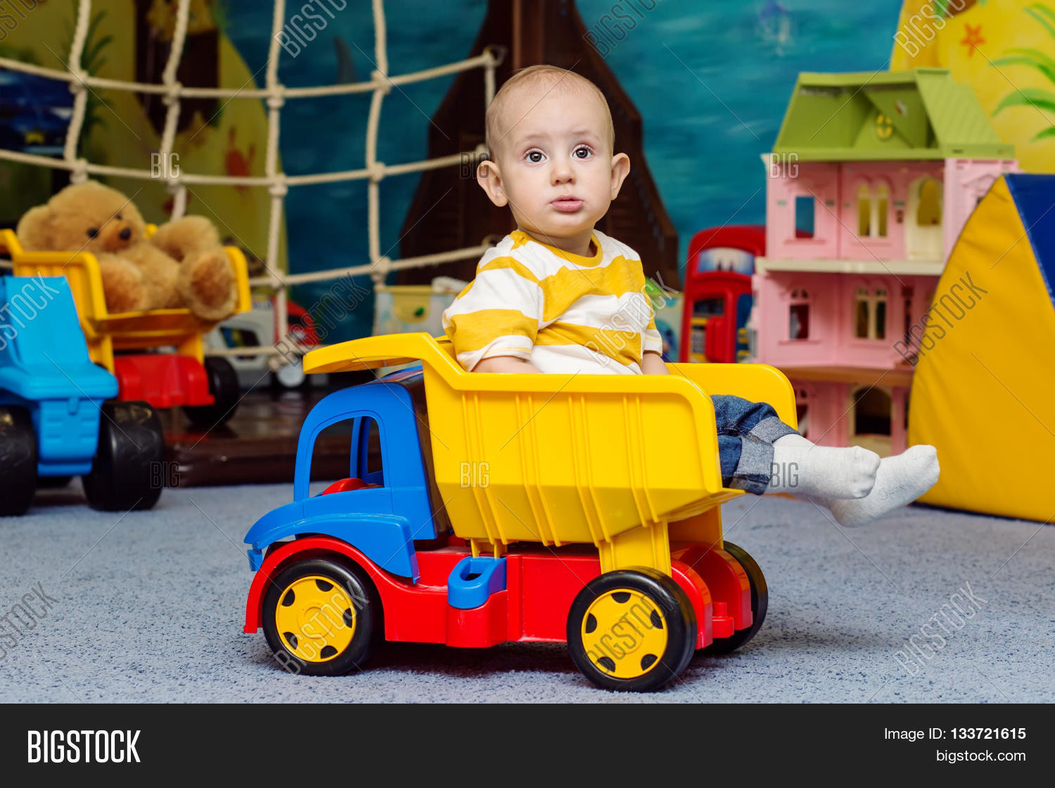 Big Boy Toys Games : Toddler boy sitting toy truck game image photo bigstock