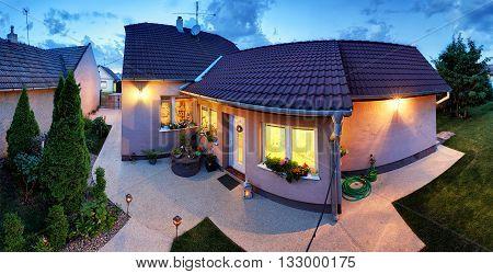 Big luxury house at dusk night panorama.