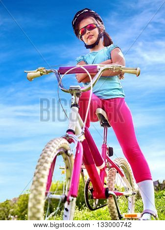 Bikes bicycling child. Child girl rides bicycle. Little girl in cycling. Cycling is good for child health. Cyclist look away.