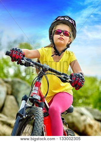 Bikes bicycle girl wearing helmet rides bicycle in park outdoor..