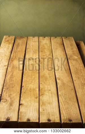 Wooden deck with vertical arrangement tabletop against grunge wall