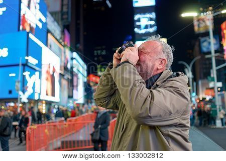 NEW YORK - CIRCA MARCH, 2016: man taking photos in New York. The City of New York, often called New York City or simply New York, is the most populous city in the United States